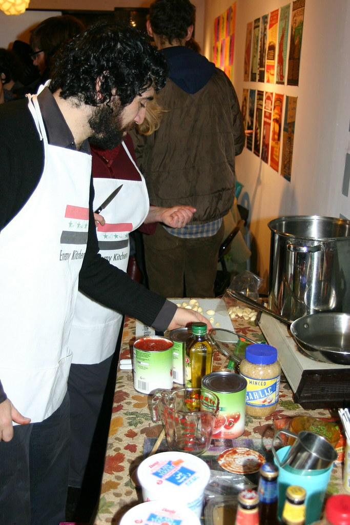 "Michael Rakowitz, Enemy Kitchen, 2003-ongoing. ""Michael Rakowitz + Lora Lode   cooking""bylefortuneis licensed underCC BY-NC-ND 2.0"